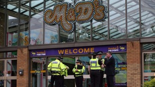 Police outside the M&D's theme park after Sunday's incident.