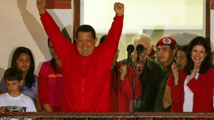 Venezuelan President Hugo Chavez celebrates from people's balcony at Miraflores Palace in Caracas