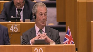 Farage laughing after his speech at the European Parliament