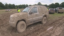 Airport parking: 1,000 cars left in muddy field