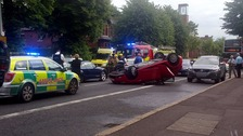 A car was left on its roof after a collision on the Lisburn Road.