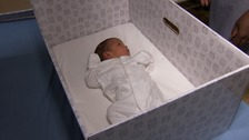 First UK hospital gives parents baby boxes in west London