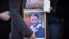 A man has been arrested over the murder of Michael McGibbon.