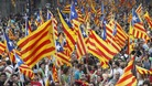 Demonstrators wave Catalonian flags on Catalan National Day in Barcelona