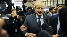London Mayor Boris Johnson arrives at Birmingham New Street Station before attending the Conservative Party conference.