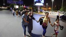 people fleeing airport