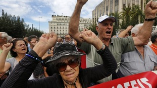 Pensioners shout slogans during a march towards the EU offices in Athens