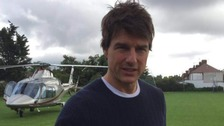 Tom Cruise makes unexpected landing in a London field