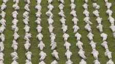 Shrouded figures laid out in memory of Battle of the Somme