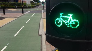 Leeds-Bradford 'cycle super highway' opens amid controversy
