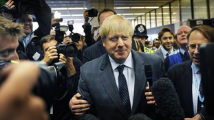 London Mayor Boris Johnson arrives at Birmingham New Street Station