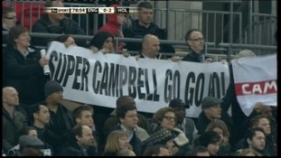 Banners in the crowd for Campbell