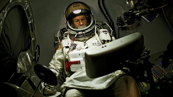 Felix Baumgartner of Austria sits in his capsule during the preparation