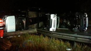 Man arrested after car transporter overturns on A34