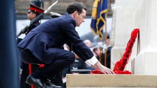 George Obsorne lays a wreath in Manchester.