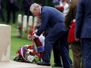 The Prince of Wales lays a wreath during a service in Thiepval.