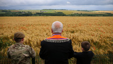 A Co Fermanagh man and his grandchildren look out at a poppy field near the Ulster Memorial Tower at Thiepval, France.