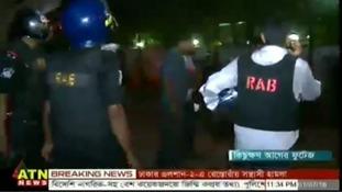 Police at the scene in Dhaka