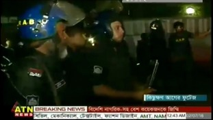 Armed officers at the scene in Dhaka