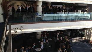 Delegates queue on two floors.