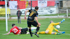 Dundalk's David McMillen fires his side into a 3-0 lead.
