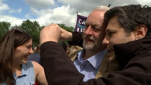 Corbyn stops to pose for a selfie with a supporter.