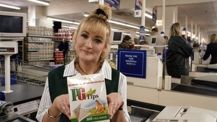 Aherne as the Checkout Girl.