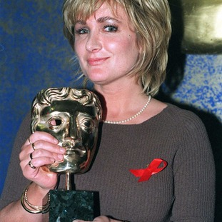 Aherne with her Caroline Aherne with her BAFTA award for Best Talk Show for the Mrs Merton Christmas Show in 1997.