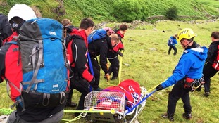 The team stretchered the woman to a waiting ambulance.