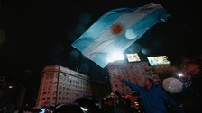 Fans waved flags and banners, lauding Messi