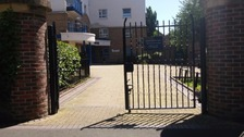 The entrance to the block of flats where the shooting happened on Friday