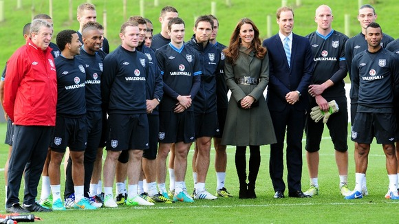 The Duke and Duchess of Cambridge pose with the England team