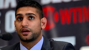 Bolton boxer Amir Khan has vowed to win back his world titles in 2013 at a press conference in London