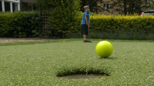 Dad turns front garden into putting green for 5-year-old golf mad son