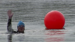 A soldier swimming.