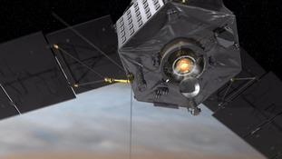 Animation images show the Juno space probe orbiting around Jupiter.