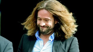 Justin Lee Collins remained silent as he left court