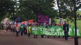 Striking teachers set off on march into city centre