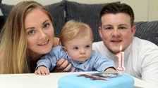 Braydon celebrates his milestone birthday with his parents.