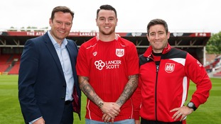 Operations Manager Mark Ashton, New signing Lee Tomlin and Head Coach Lee Johnson at Ashton Gate today