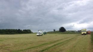Helicopter in a field by an ambulance
