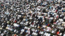 Thousands take part in prayer in Small Heath Park in Birmingham.