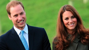 William and Kate talking to football officials