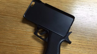Passenger stopped at Stansted Airport with phone case shaped like a gun