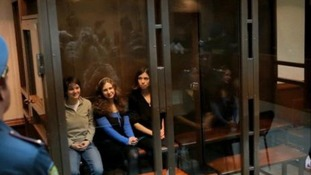 Maria Alekhina, Yekaterina Samutsevich and Nadezhda Tolokonnikova in a glass cage in a court room in Moscow