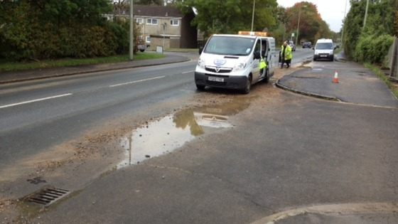 Thames Water engineers work on the burst pipe