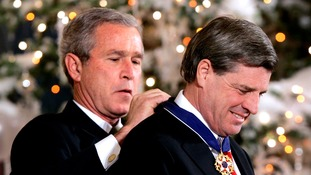 Former US President George Bush awards the Presidential Medal of Freedom to former Iraqi administrator Paul Bremer in 2004.
