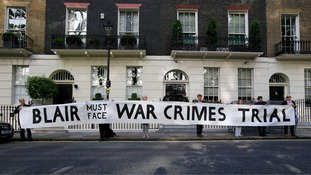 Protesters hold a banner in London ahead of the report's publication.