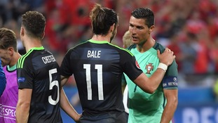 Portugal's Cristiano Ronaldo chats to Wales' Gareth Bale after defeating them in the Euros semi-final