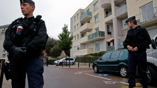 French police secure a garage in Torcy near Paris where the raid was carried out